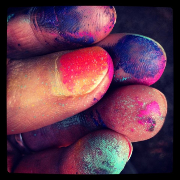 Spray paint on fingers bright colors fingerprints